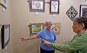 Neva Bahruth and Jeanne Baird view the Alzheimer's Association traveling art exhibit.