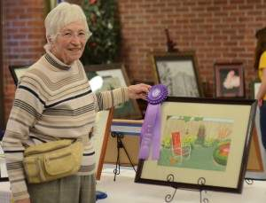"Mary Koogle with her Best in Show piece, ""Mother's Chair."""
