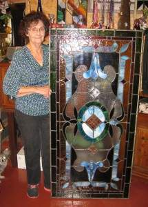 Dorothy Jefferies with a stained glass piece she created in her workshop.