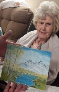Marian Rajewski, mother of Executive Director Michael Rajewski, shows the painting she created in her art class.