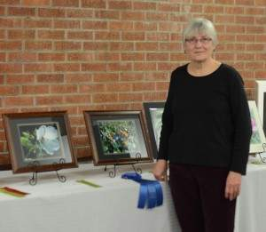 Jannie Hannon standing next to her artwork.