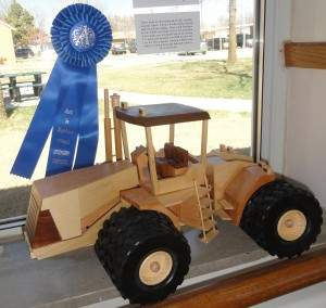 """4-Wheel Articulated Tractor,"" a handmade wooden tractor by Verne Goering of Moundridge."