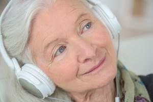 Senior Woman Listening to Music.