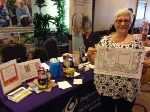 Bonnie Pewterbaugh holding the Zentangle she created, inspired by the designs on the placemats.