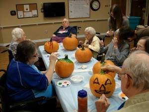 Residents paint pumpkins at Sterling Presbyterian Manor