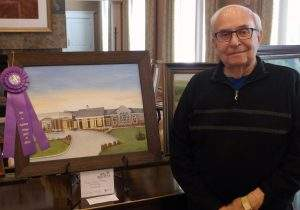 """Gary Stalh stands next to his panting, """"Our New Home."""""""