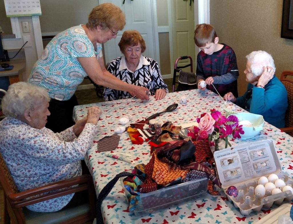 CNA Fran Michaels helps the ladies in Tranquility House make Easter eggs. Bonnie Lewis, Velma Williams, Jean McFarland, and Betty Swenty.