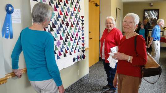 Residents and guests enjoy the Art is Ageless Exhibit at Newton Presbyterian Manor.