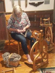 Susan Jones with her spinning wheel.