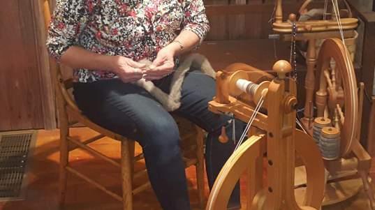 Susan Jones with her spinning wheel.
