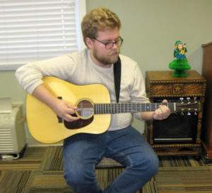 Rolla High School graduate Thomas Hardwick plays the guitar to residents at Rolla Presbyterian Manor.