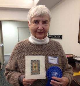 "Susan Burchill placed first in amateur needlework with her piece ""Small Navajo Rug."""