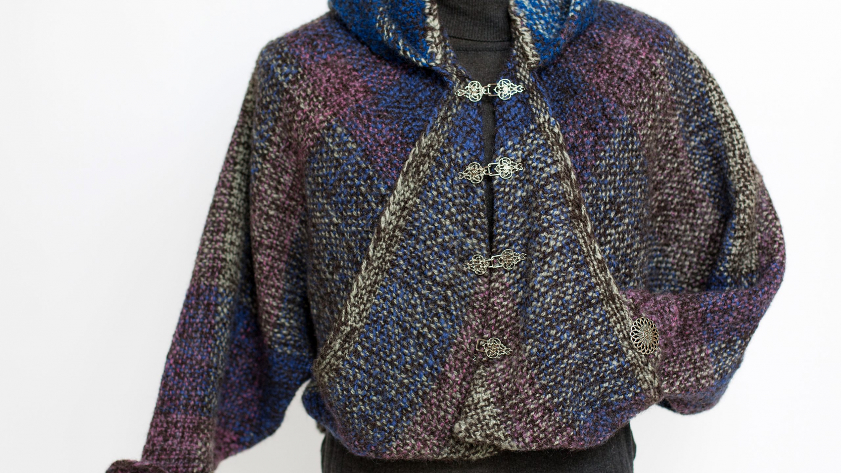A woven wool jacket in blue, magenta, black and tan.