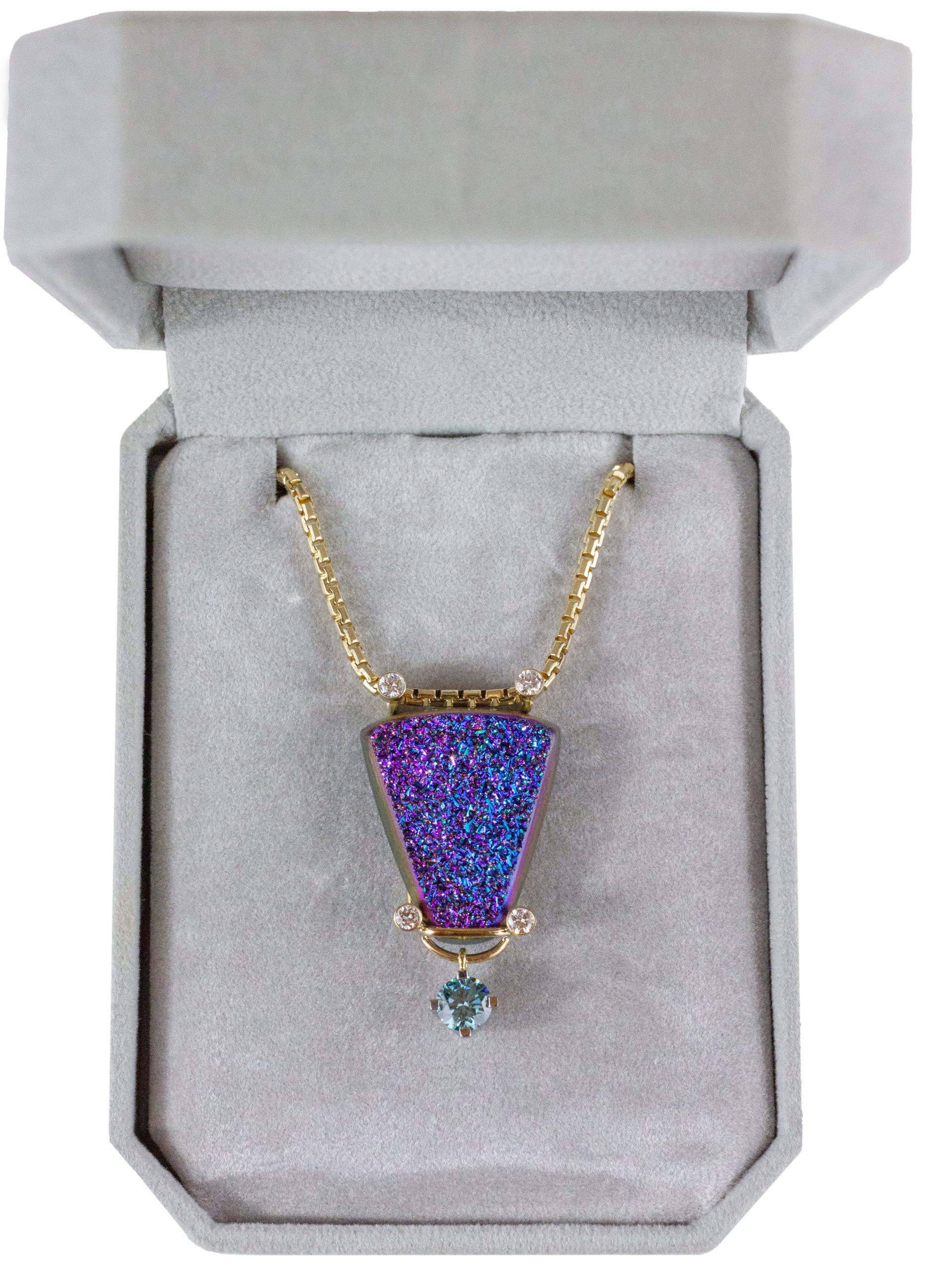 Blue triangular pendant with light blue stone.