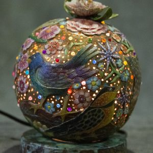 Mixed Media Crafts - Presence - accent lamp made from a gord that is intricately carved and painted with a variety of colorful flowers and birds.