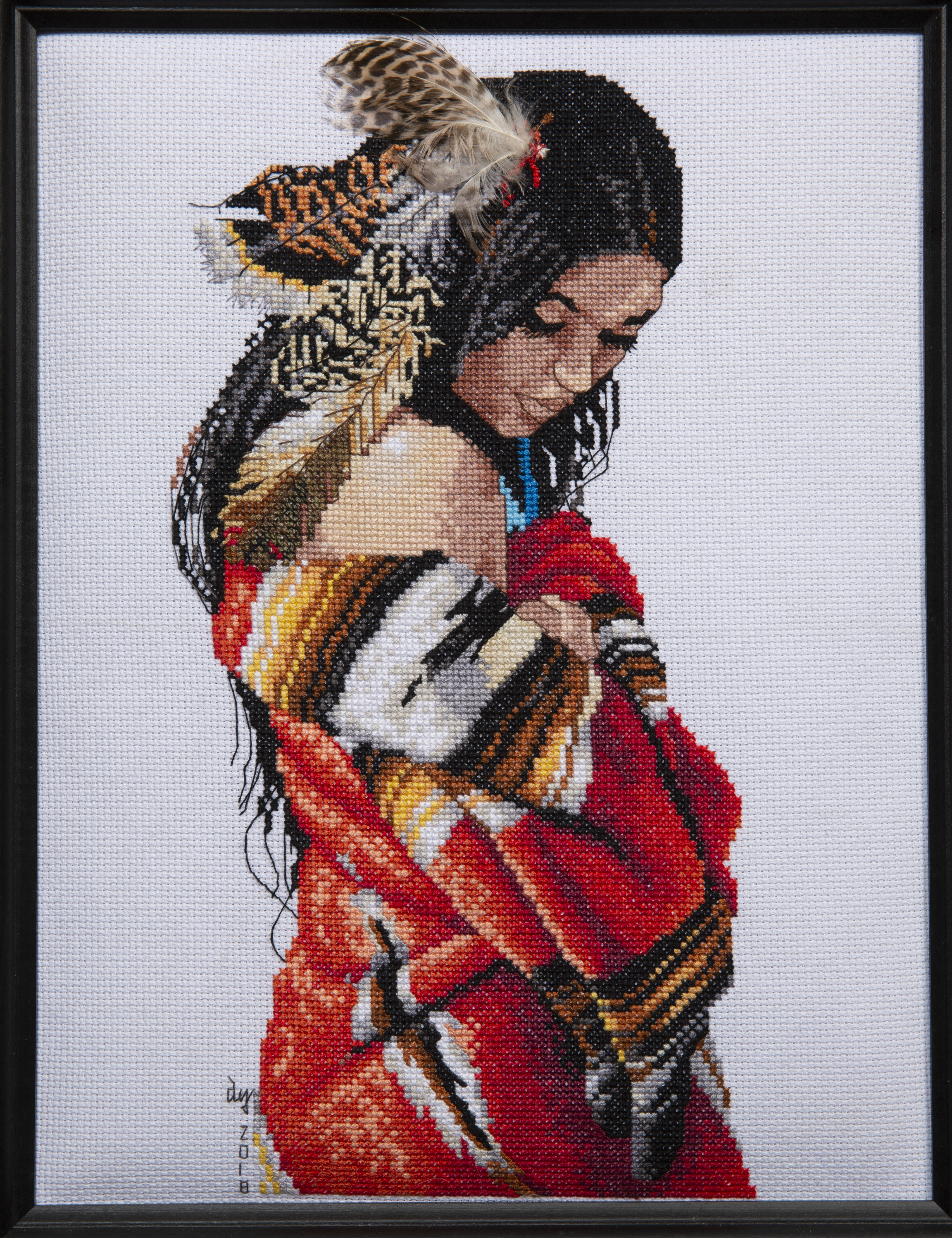 Needlework - Indian Maiden - needlework of young indian maiden with various feathers in her hair and wrapped in colorful red, yellow, white and black blanket.