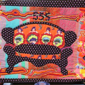 Quilting - 555 Couch - Image of quilt made of vibrant colors in reds, pinks, purple, orange, blue, yellow, that features a black and purple polka dot couch with 4 can-can dancers above the couch and the numbers 555 quilted at the top.