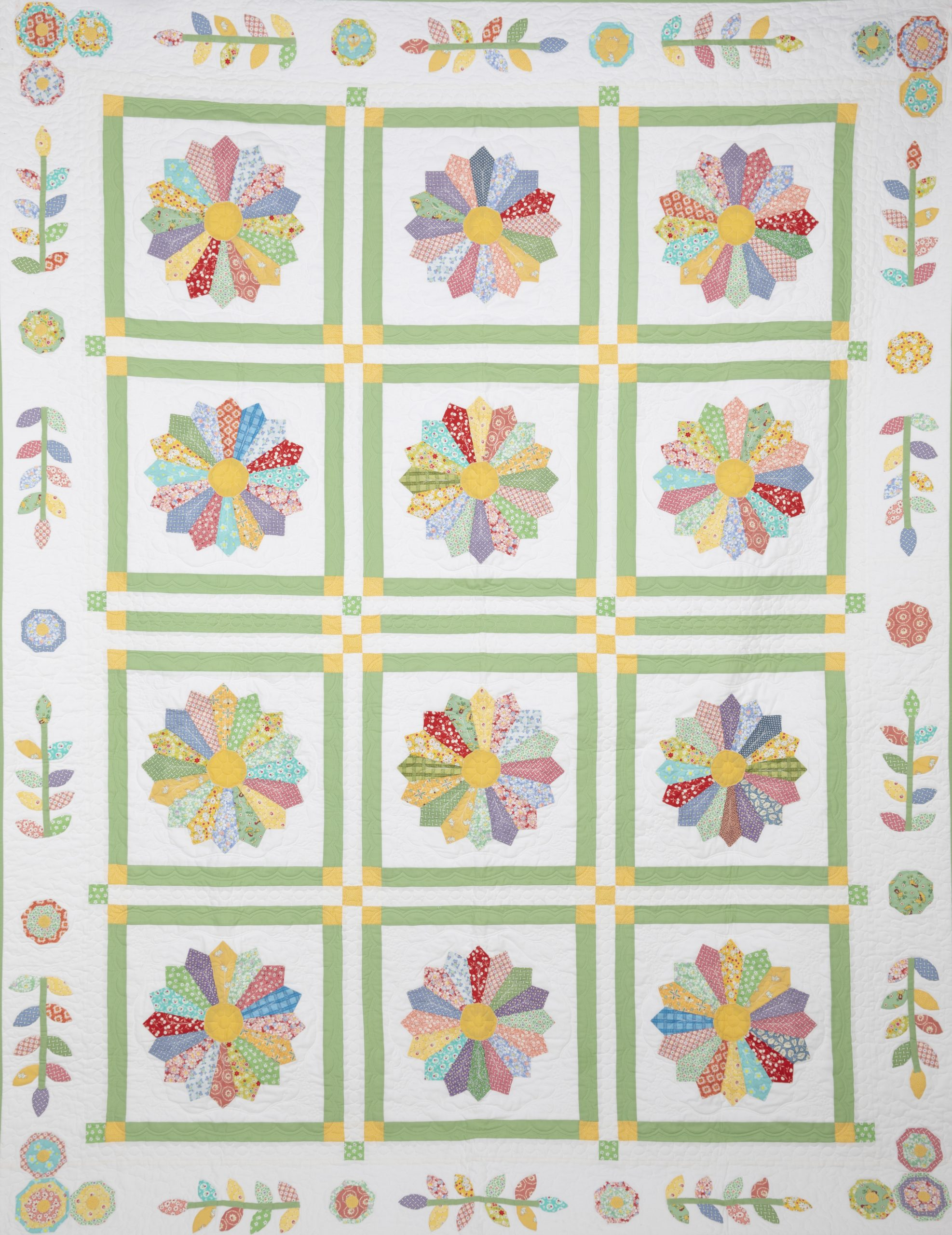 Quilt featuring colorful flower squares entitled Dresden Flower Garden