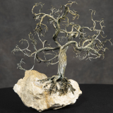 Sculpture 3D - Sculptural Tree - sculpture of a tree made of various pieces of wire that are mounted on a rock.