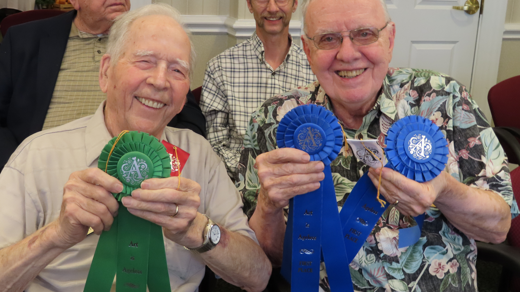 Bill Walter (L) and Ed Duman (R), show off their ribbons. Ed is the winner in the amateur Christmas category, and Bill was a Judge's choice winner in the amateur division. Both men live at Aberdeen Village.