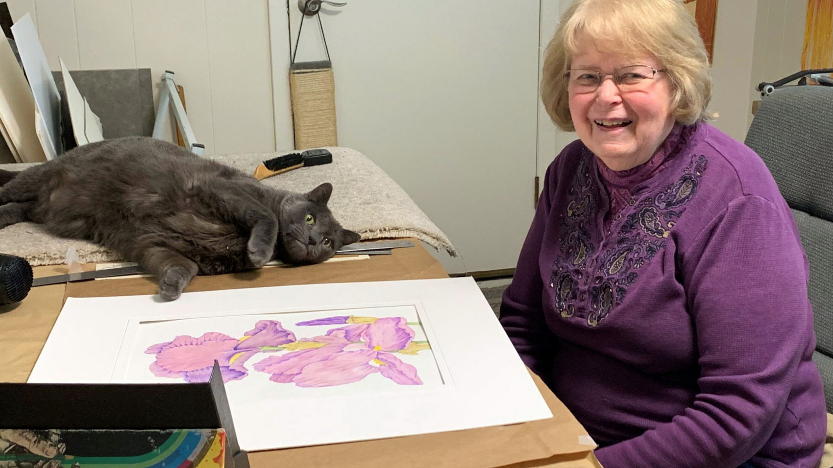 Betty works in her studio at home with Bobo the cat.